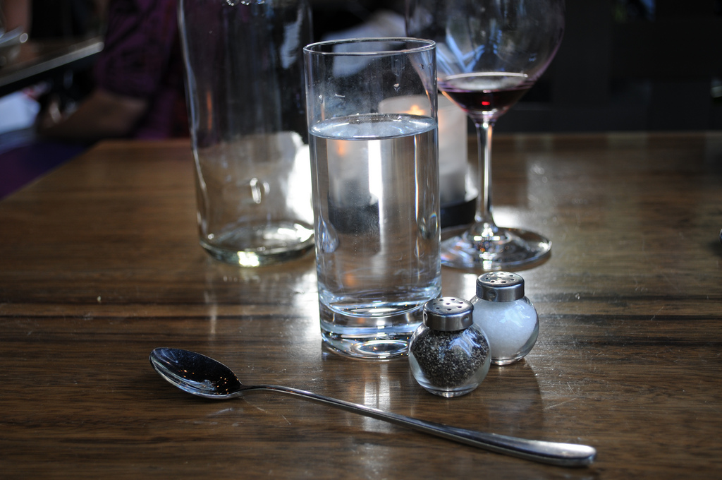 """Various items on table at Purple Cafe"" by D Coetzee"