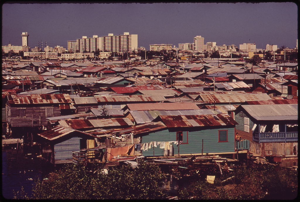 Modern Buildings Tower over the Shanties Crowded Along the Martin Pena Canal 02/1973